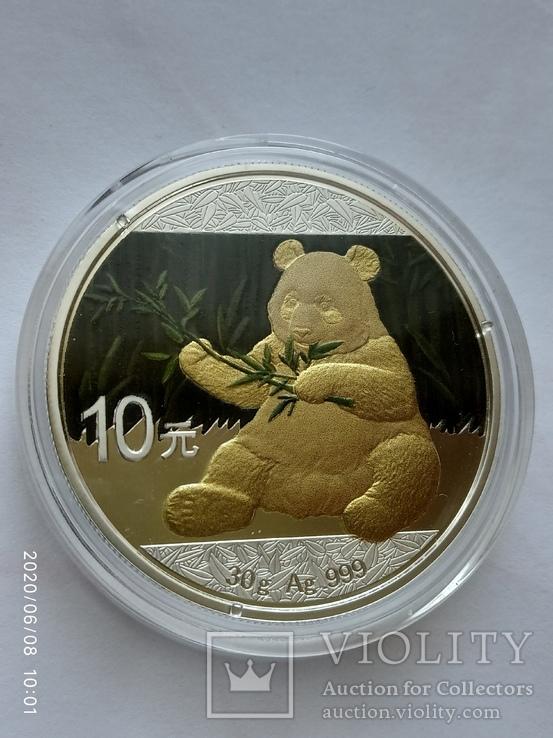 Китайская панда 10 юаней 2017 год.1 унция серебра+позолота.Тираж 100 экземпляров., фото №2