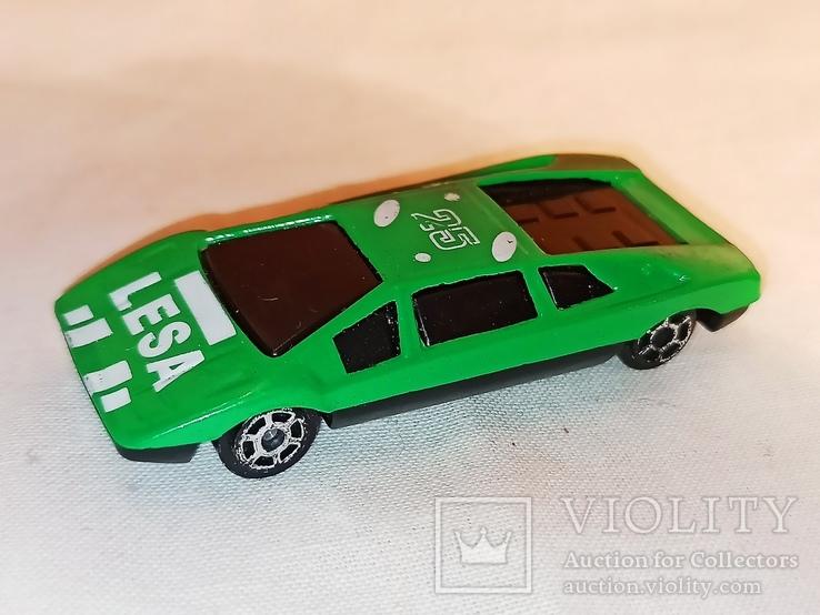 Модель, моделька зелёного гоночного автомобиля., фото №2