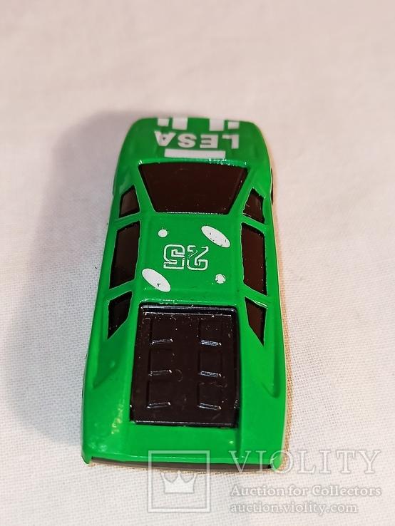 Модель, моделька зелёного гоночного автомобиля., фото №5