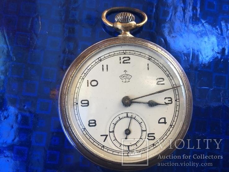 Часы (thiel)