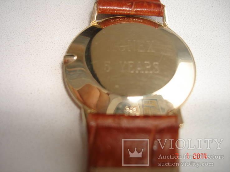 Часы золотые Омега, фото №5