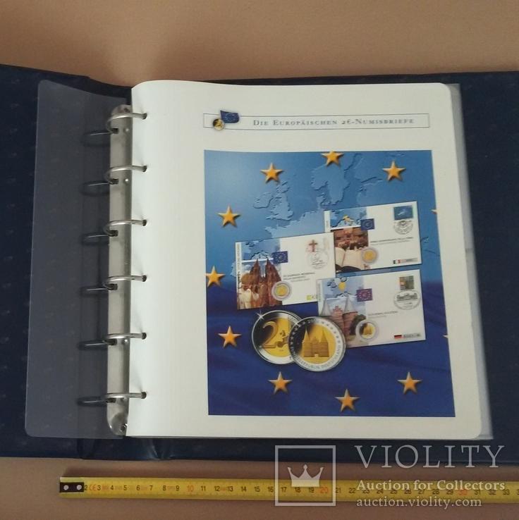 Семь монет по 2 евро в  семи конвертах и альбоме., фото №2