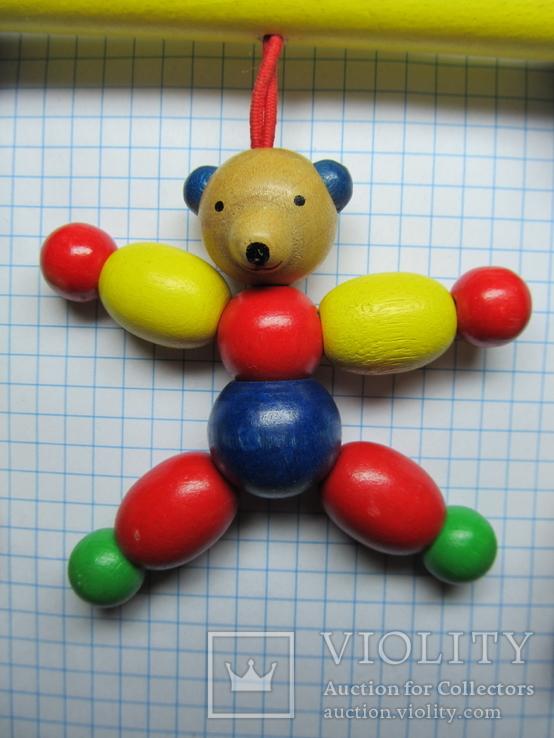 Деревяная игрушка с прищепкой и колокольчиками на коляску, фото №3