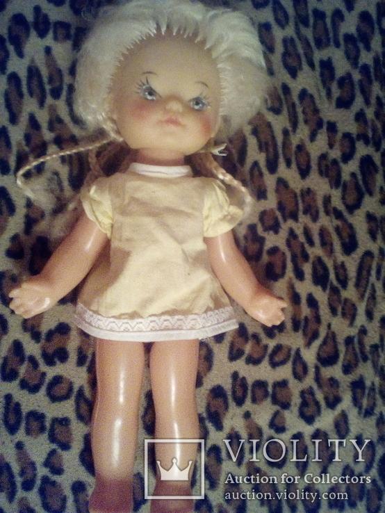 Куколка с красивым лицом