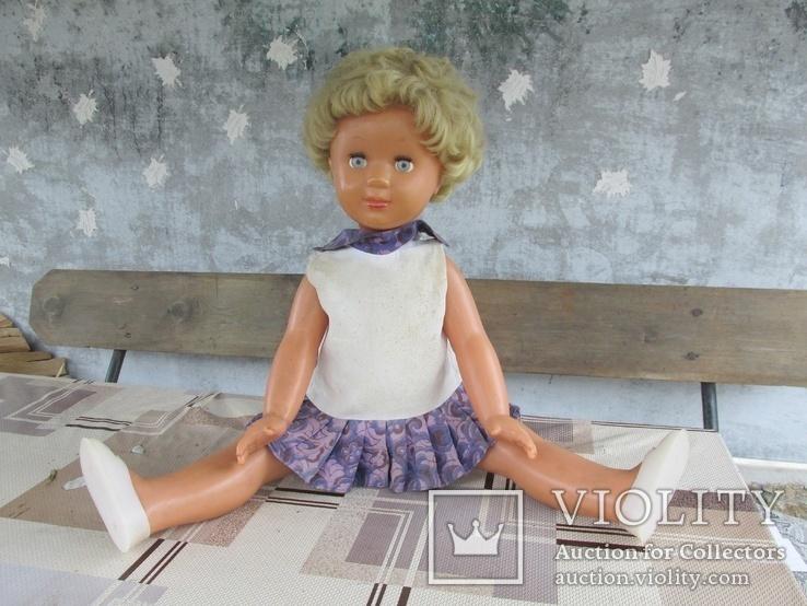 Кукла(клеймо)на резинках с пищалкой.