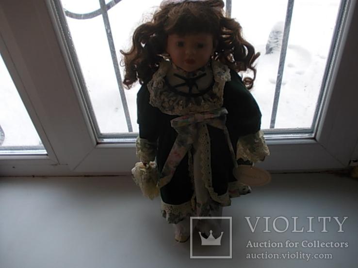 Фарфоровая кукла. Monique Финляндия  41 см.