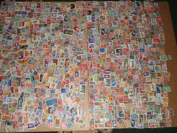 Марки оптом 1033 штуки  розпродаж , різних країн світу