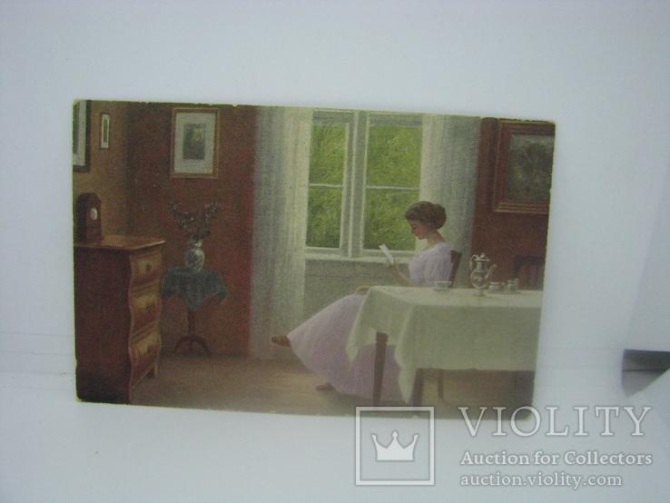 Открытка Девушка читает книгу в столовой возле окна