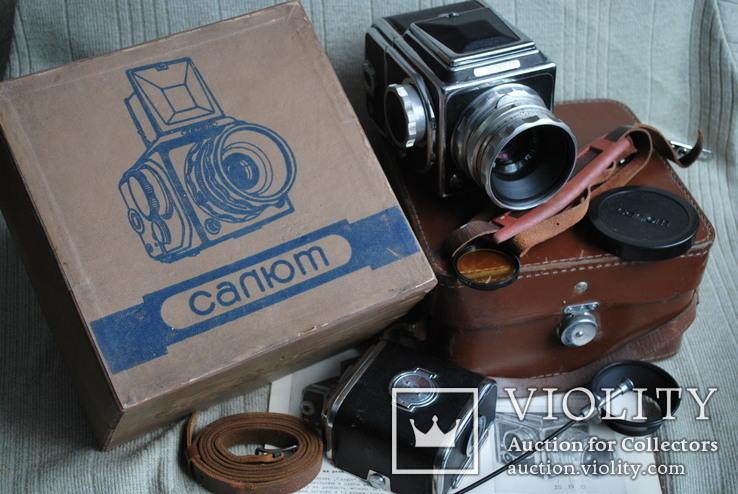 Фотоаппарат САЛЮТ, с авто спуском, № 00 519, Индустар-29, первый, в упаковке.