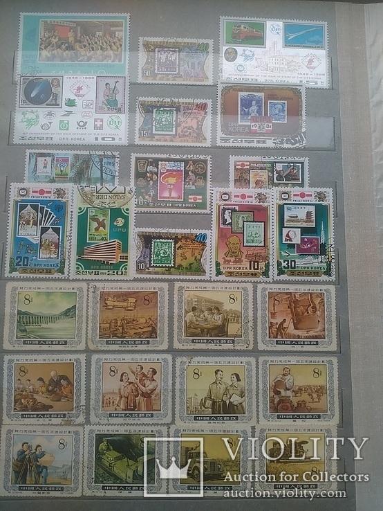 Альбом марок северной кореи и китая более 400 шт