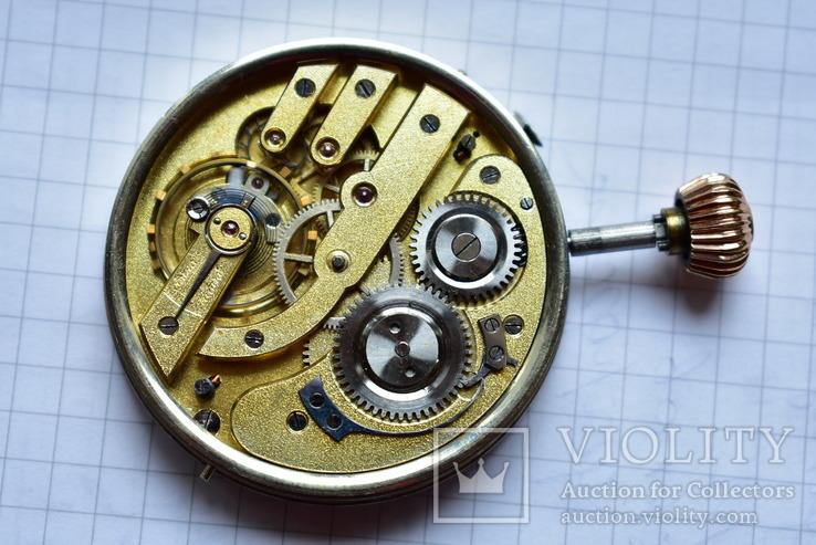 Механизм из трехкрышечных золотых часов