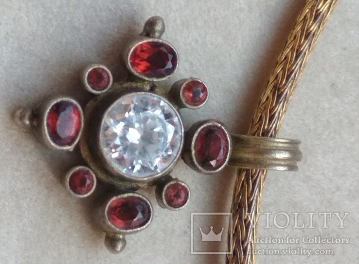 Старое серебряное украшение, позолота, камни.