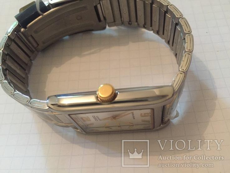 Лот 0039 Новые женские часы Casio (оригинал) MTP-1235SG-7ADF DI, фото №5