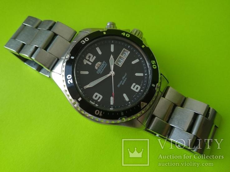 Часы. Ориент / Orient EM 65 - A00 T - на ходу, фото №2