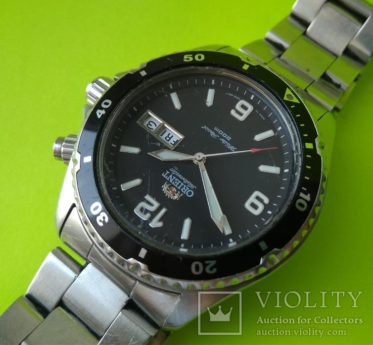 Часы. Ориент / Orient EM 65 - A00 T - на ходу, фото №7