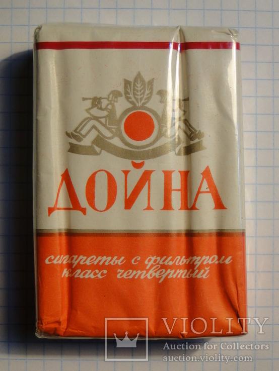 Купить сигареты дойна купить бонд с кнопкой сигареты