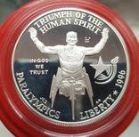 США 1 доллар 1996 г.  XXVI Летние Олимпийские игры 1996 года в Атланте. Гонки на колясках, фото №2