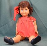 Лялька пластикова в червоному платті