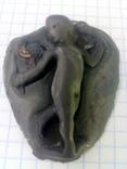 Ангелочек со змеёй в руке