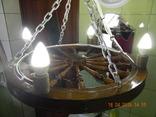 Люстра из колеса прялки на цепях