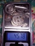 Серебро чк.пряга,окончание ремня,амулет,монеты.45.78гр и две позолоченые серьги.