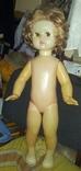 Большая кукла (двигает глазами). СССР