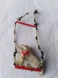 Елочная игрушка собачка на каталке склярус