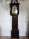 Старий англійський годинник в різьбленому корпусі
