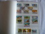 Около 200 марок и 56 сцепок,м.л., темы Фауна,флора в альбоме photo 2