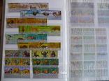 Около 200 марок и 56 сцепок,м.л., темы Фауна,флора в альбоме photo 3