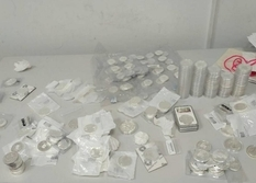 Customs officers seized a collection of silver coins and medals, which they tried to import illegally