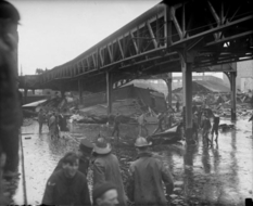 Tilted train and demolished bridge racks - consequences of an explosion at a Boston distillery