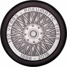 In France, released a souvenir coin in the shape of a wheel with a real rubber tire