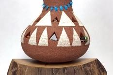 Unusual workshop inside a ceramic pot