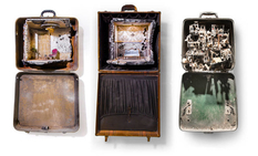 Miniature stories embedded in old suitcases