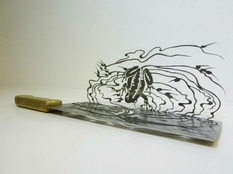 Художник из Пекина создает ножи с подтекстом (Фото)