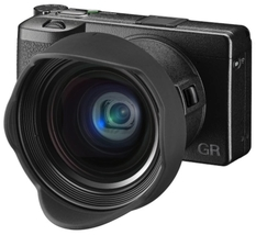 Ricoh GR III is a compact camera with a large sensor