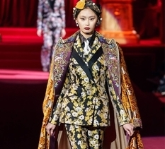 Dresses and suits at fashion week by Dolce & Gabbana