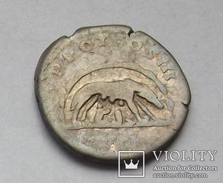 Денарий Антонина Пия (Волчица).RIC 95b.(Император в венке).