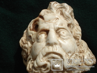 Голова божества,мрамор