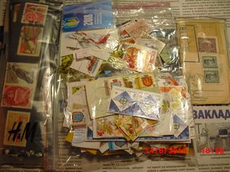 Вырезки, гаш. марки около 650 и другое, см. описание