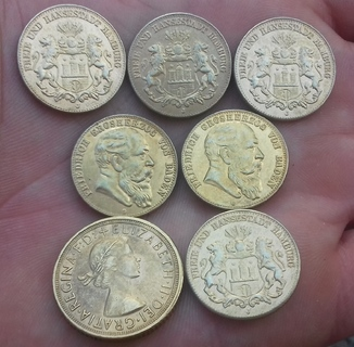 Копии золотых монет 7 штук.