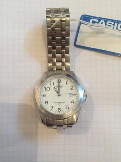 Лот 0098 Новые мужские часы Casio (оригинал) MTP-1222A-7BVEF