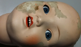 Голова старой куклы