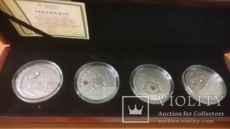 Набор ''Сказки'' серебро 4 монеты по 28,28 г. с цирконами и янтарем.