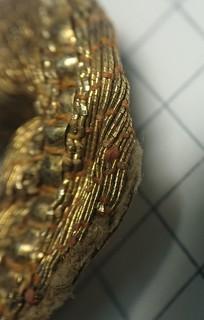 Фрагмент украшения одежды или аксессуара
