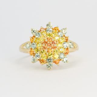 Золотое кольцо с разноцветными натуральными сапфирами.