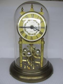 Каминные, настольные часы Estyma Quartz в стеклянной колбе. Германия