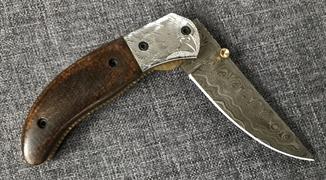 Складной нож из Дамасской стали.