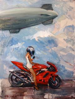 Девушка на мотоцикле.